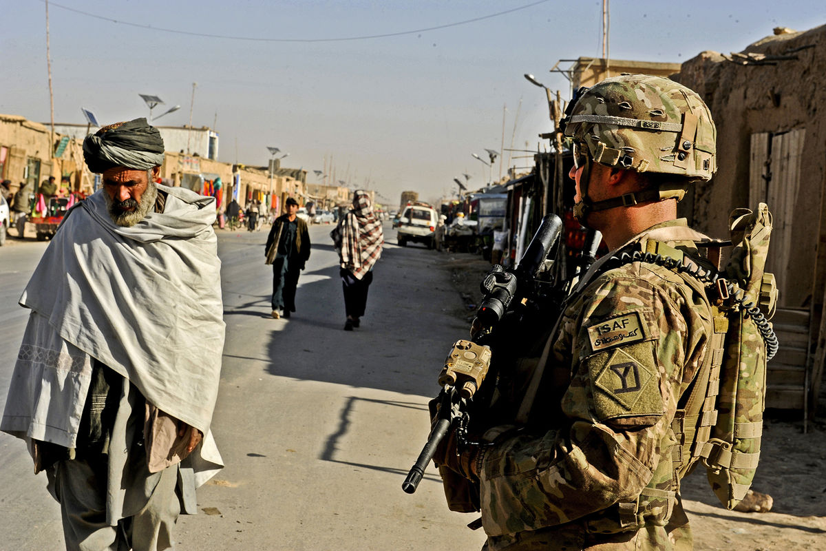 U.S. Army Spc. Jason Bruno secures an area during an assessment of the local bazaar in the Shah Joy district of Zabul province, Afghanistan, on Dec. 7, 2011. Bruno is a rifleman assigned to Provincial Reconstruction Team Zabul.