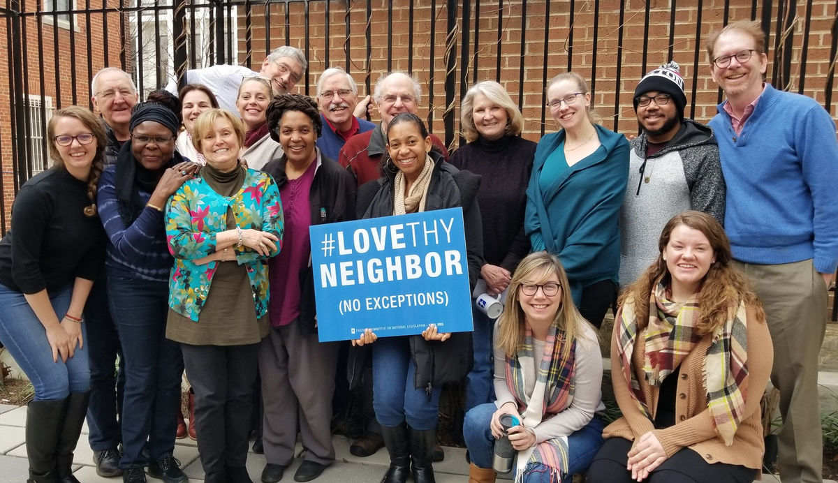 Field and Annual Meeting Planning Committees with Love Thy Neighbor Sign
