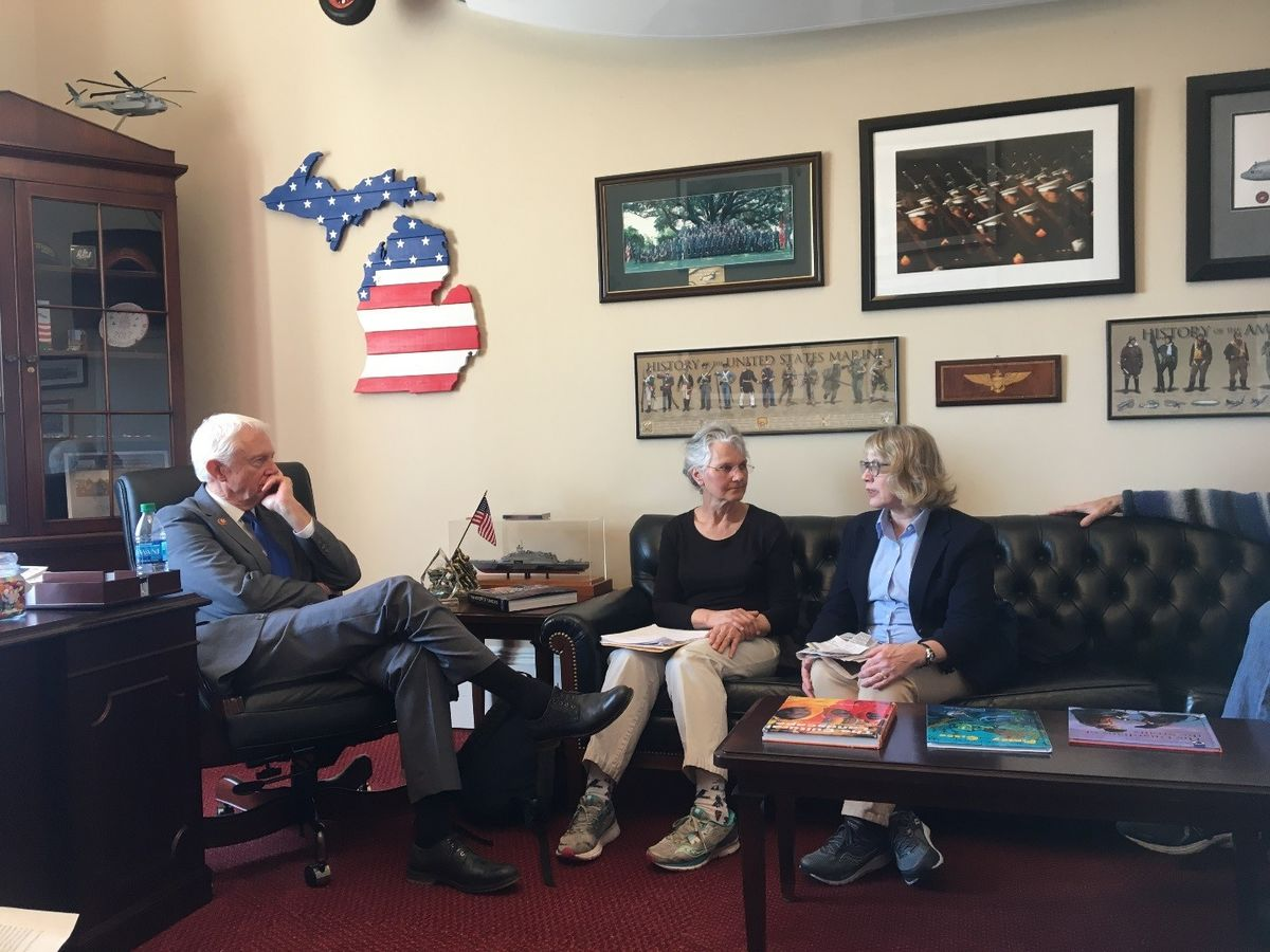 Eileen Smit and Tricia Slotterback lobby Rep. Jack Bergman (MI-01) on climate issues.