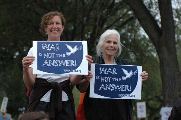 Advocates holding signs that say War is Not the Answer