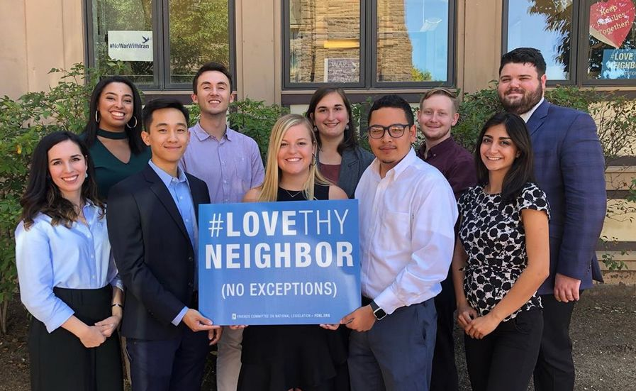 FCNL Young Fellows holding a Love They Neighbor sign