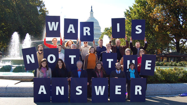 "Group of advocates holding ""War Is Not The Answer"" signs"