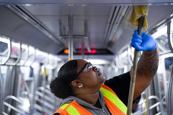 MTA New York City Transit personnel perform disinfectant sanitization aboard subway car March 3, 2020, as a precautionary measure in response to the novel coronavirus (COVID-19).