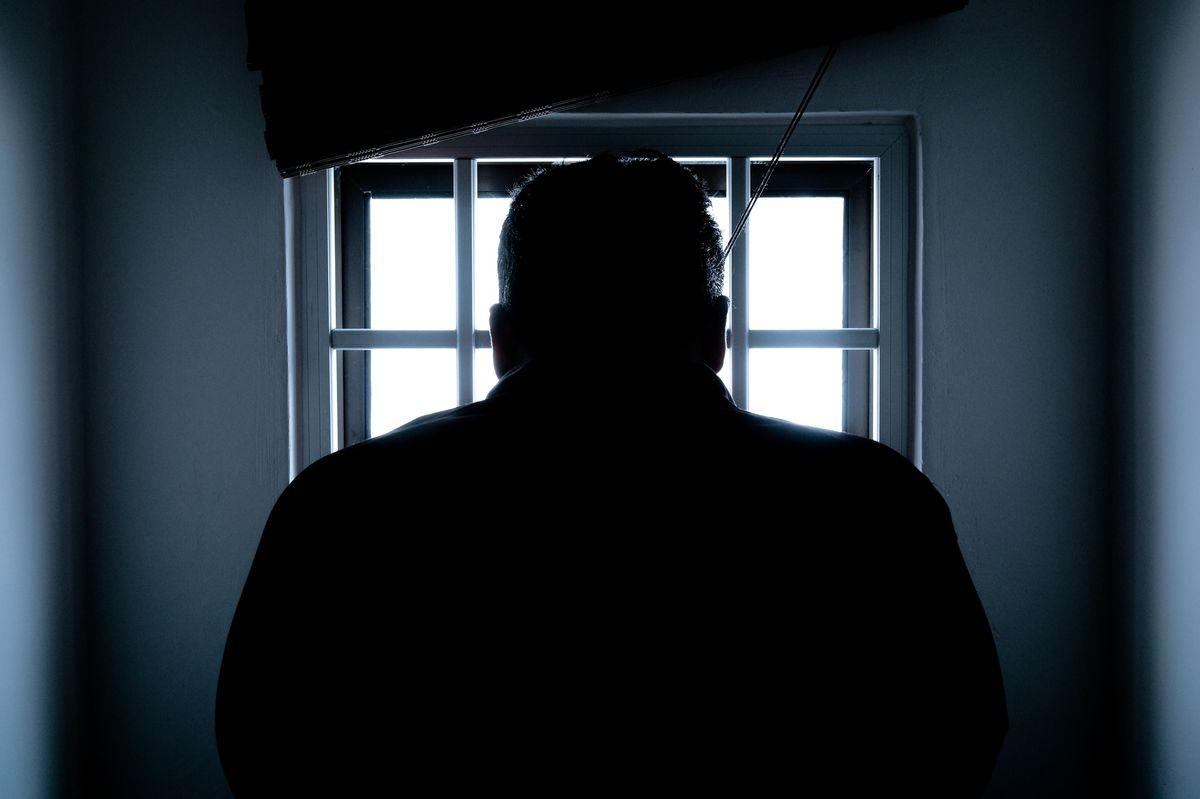 Silhouette of man in window.