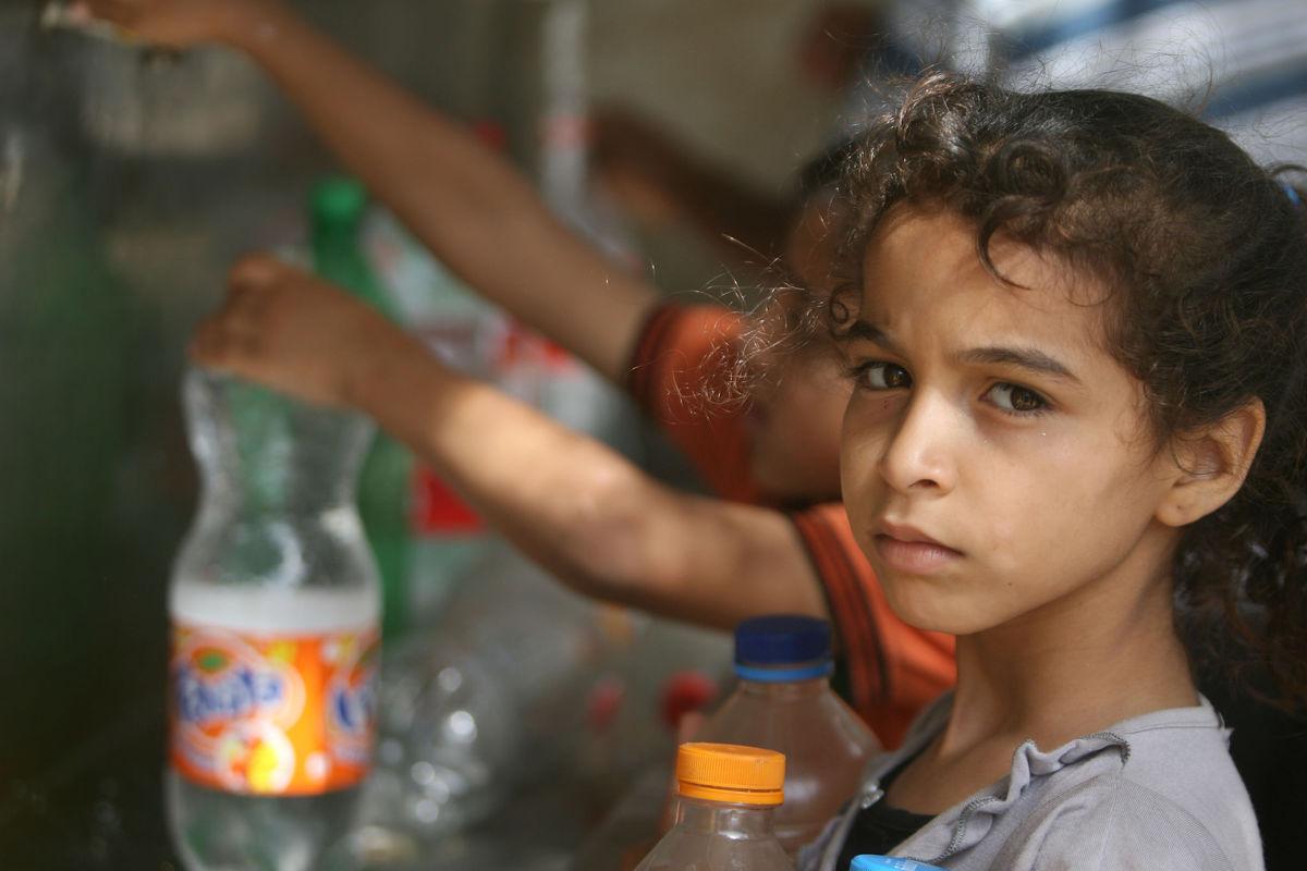 Children in Gaza collect water