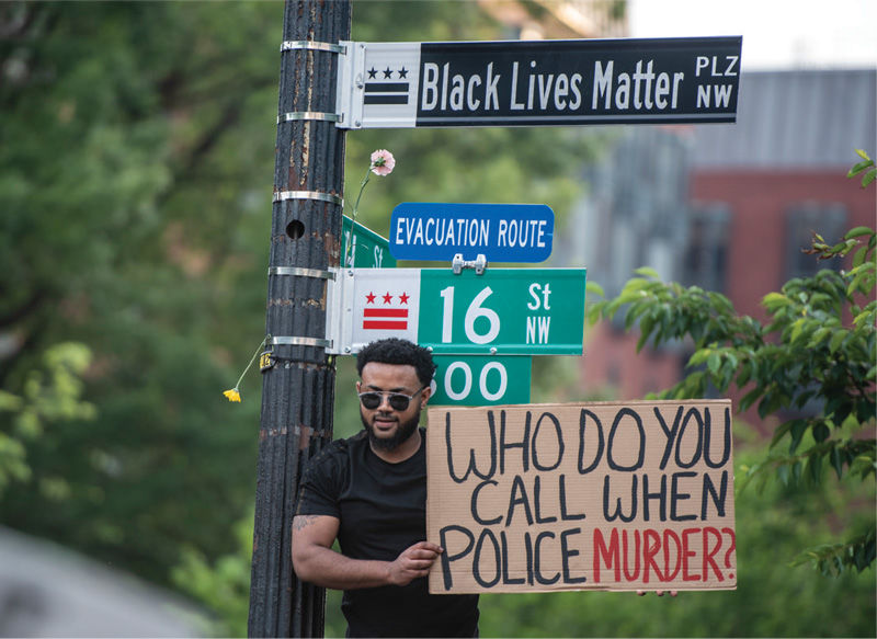 Who do you call? Protest picture.