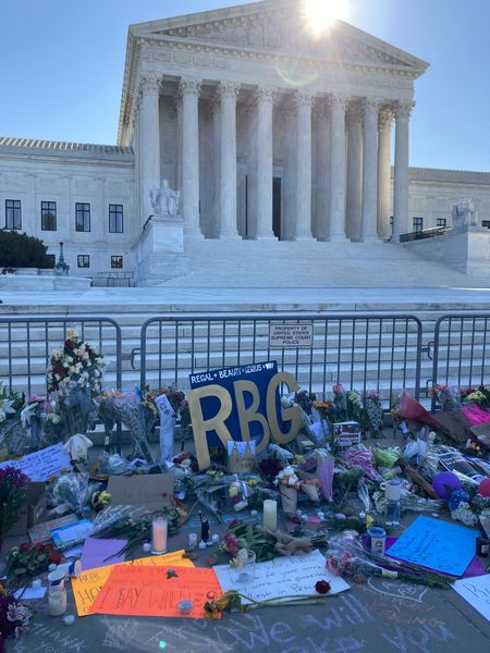 People pay their respects at the Supreme Court following the death of Justice Ruth Bader Ginsburg.