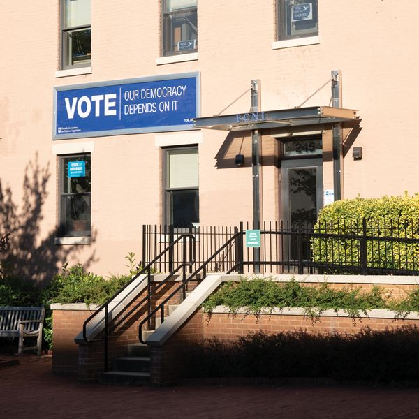 A new banner hangs from the FCNL building.