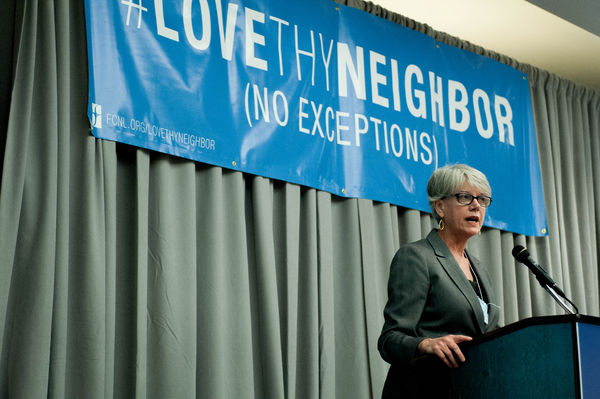 Diane Randall speaks at podium
