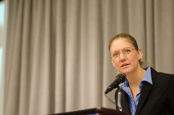 Amelia Kegan speaks at podium
