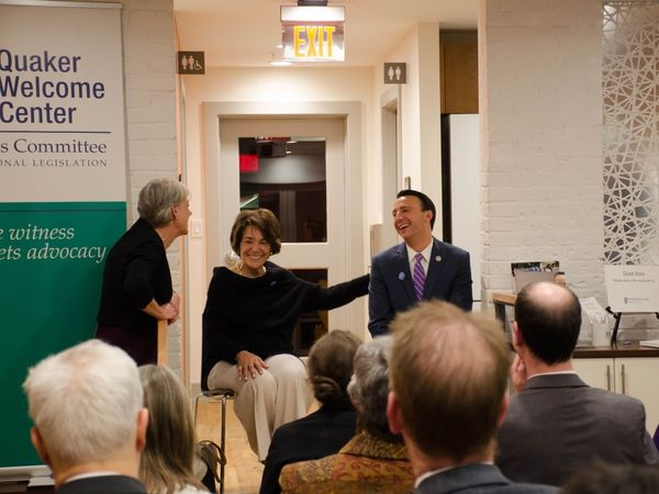 Diane Randall laughs with representatives Ryan Costello and Anna Eshoo at an event held in the Quaker Welcome Center