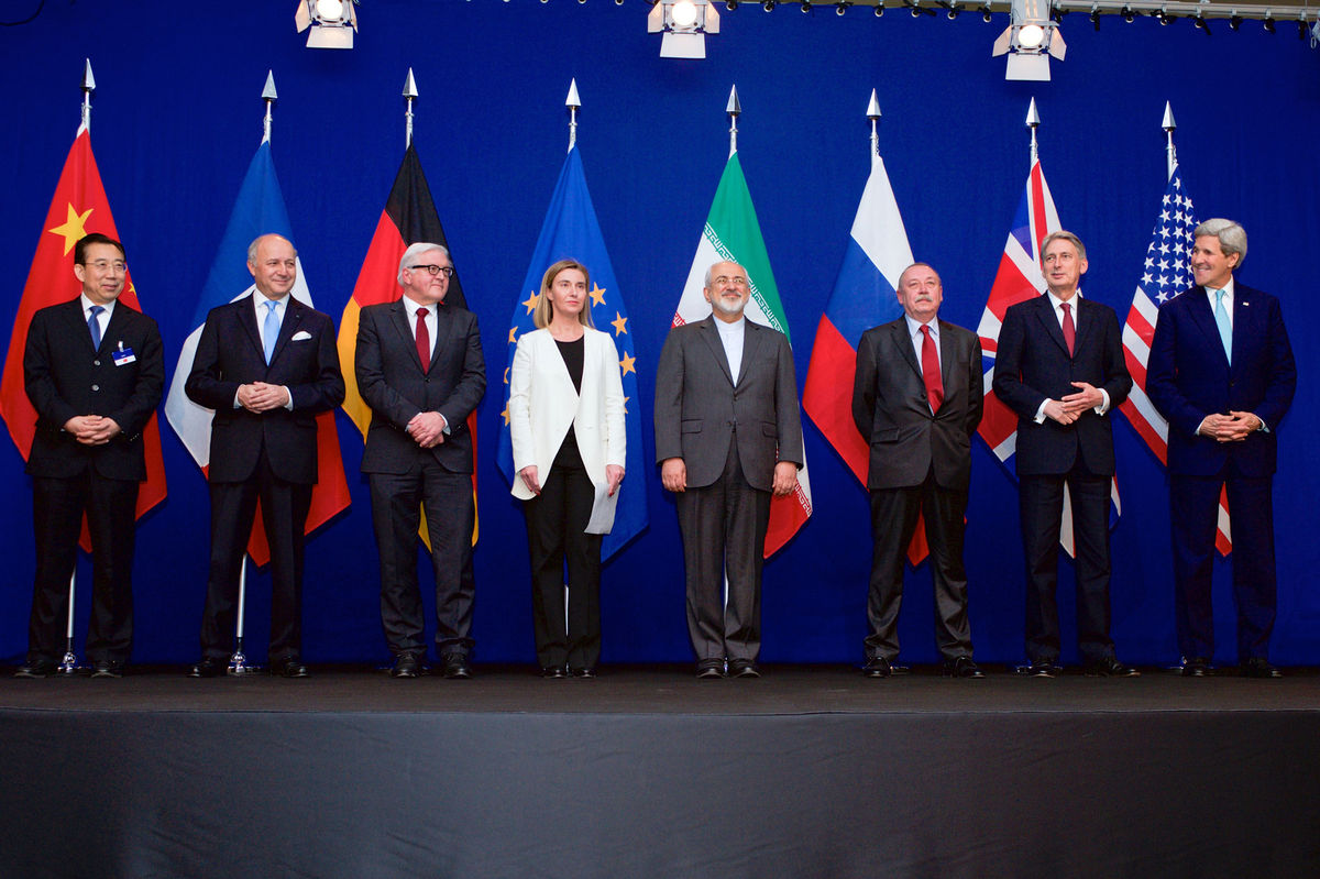 Diplomats stand in front of their flags after reaching the Iran deal